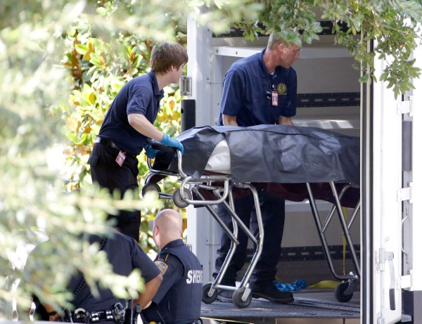 Image: A body is removed from a home