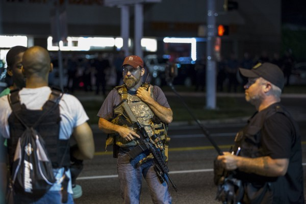 Image: Members of the Oath Keepers walk with their personal weapons on the street during protests in Ferguson, Missouri