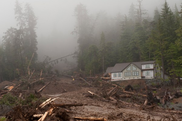 Image: A house under construction sits next to a landslide