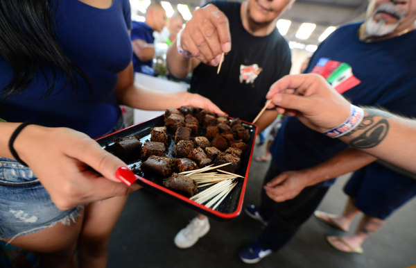 Image: Care-carrying medical marijuana patients sample the brownies