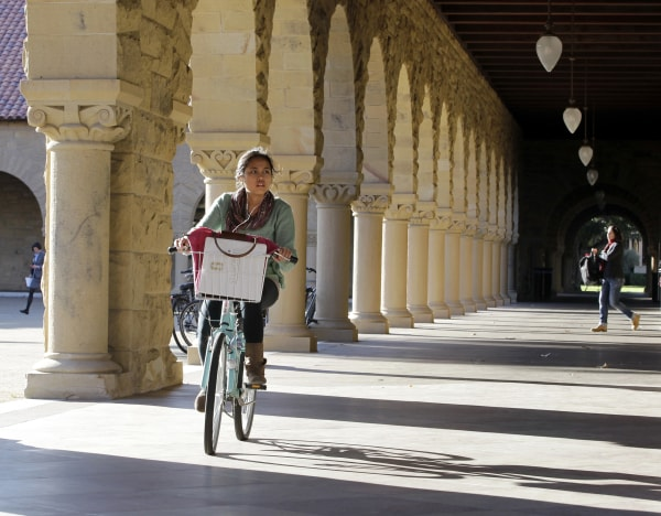 A Stanford University student bikes her way through the halls on the Stanford University