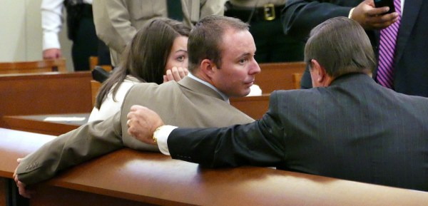 Image: Randall Kerrick and his wife Carrie talk with attorney George Laughrun
