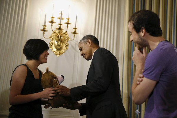Image: President Obama meets Chung and Horowitz of Sproutel as he views exhibits at the White House Demo Day at the White House in Washington