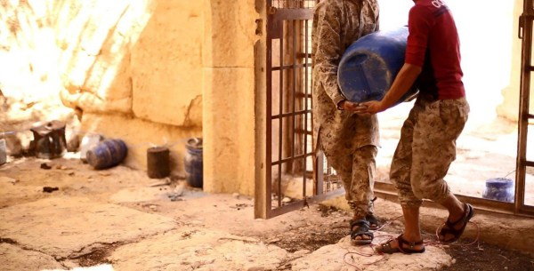 Image: ISIS image appears to show militants carrying a bomb into the Baal Shamin temple