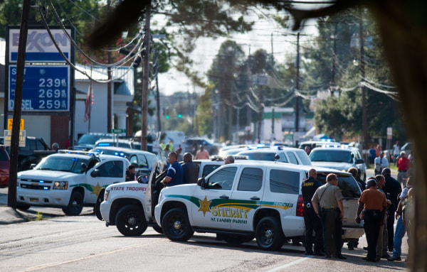 Image: Police gather at the scene of a shooting in Sunset, La.
