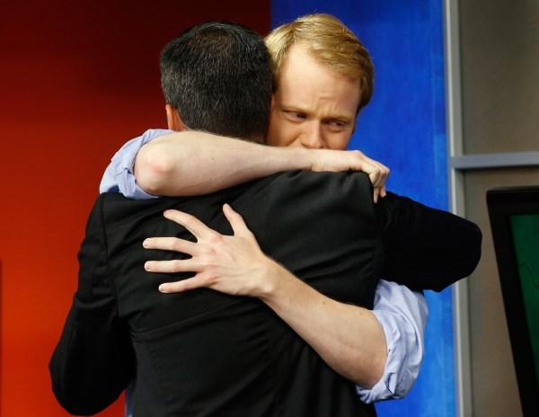Image: WDBJ-TV7 anchor Chris Hurst, right, hugs meteorologist Leo Hirsbrunner