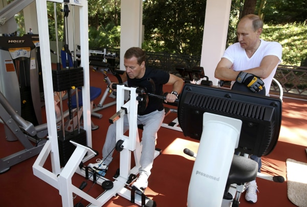 Image: Russian President Putin and Prime Minister Medvedev exercise in a gym at the Bocharov Ruchei state residence in Sochi