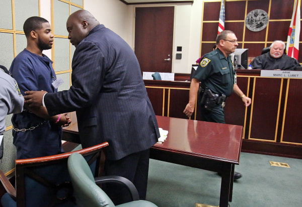 Image: Former FAMU percussionist Caleb Jackson, left, confers with his attorney
