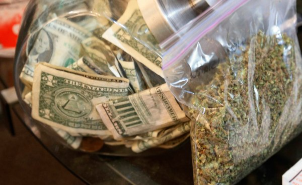 Image: A bag of marijuana being prepared for sale