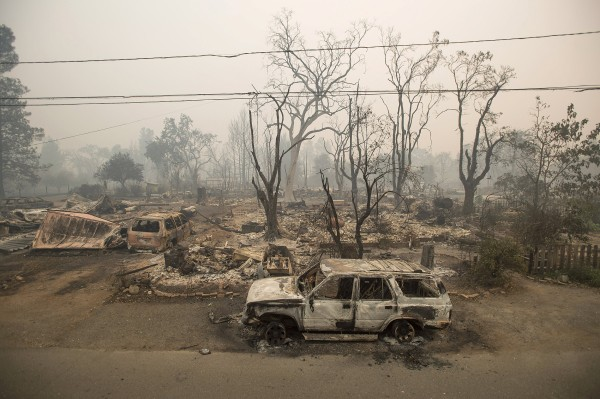 Image: Burned out remains of vehicles and homes scorched by the Valley Fire line Wardlaw St. in Middletown