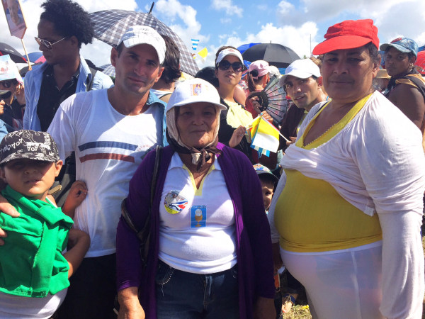 Image: Inocencia Montoya and her family at the mass to meet Pope in Holguin
