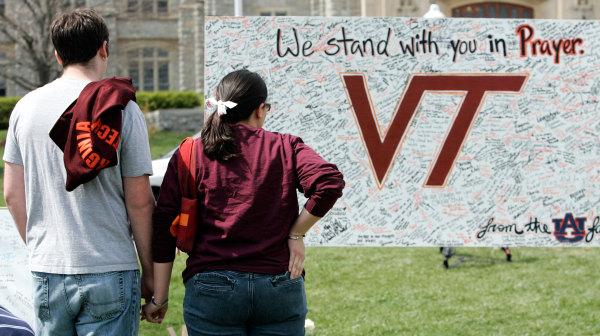 Image: Students visit a makeshift memorial