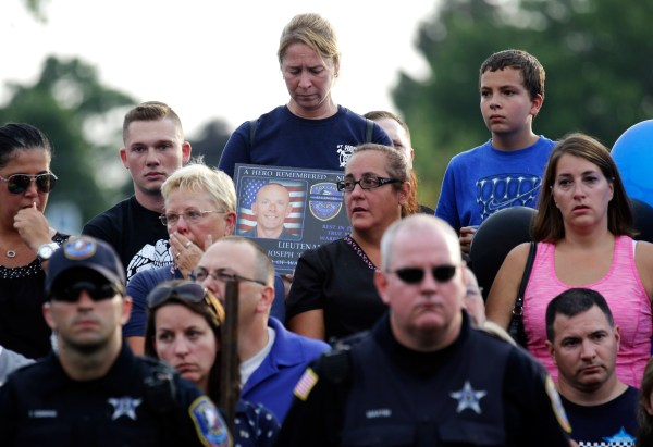 Image: Mourners attend a vigil at Lakefront Park to honor the memory of Fox Lake Police Lt. Charles Joseph Gliniewicz