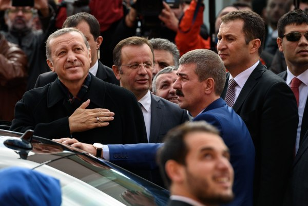 Image:Turkish President Recep Tayyip Erdogan (left) gestures to supporters
