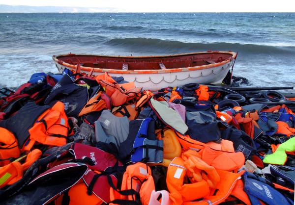 Image: Life jackets used by migrants dumped on Lesbos, Greece