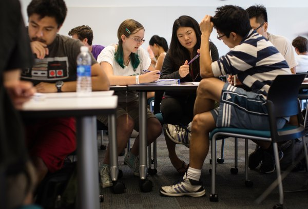 Image: Students work in a group to problem solve during a chemical and thermal processes class at Harvey Mudd College