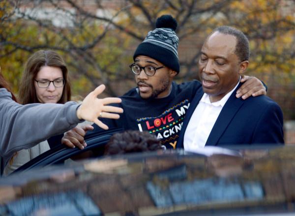 Image: Jonathan Butler enters a car