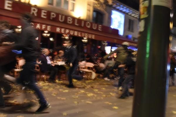 Image: People flee after attack near Place de la Republique in Paris