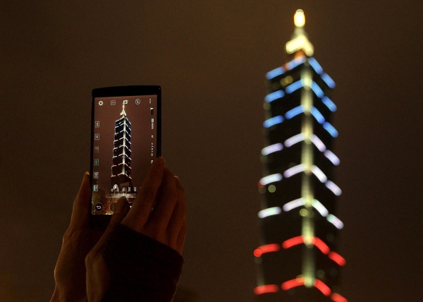 Image: Taiwan's landmark building Taipei 101 is lit up in blue, white and red, the colors of the French flag, following the Paris attacks, in Taipei