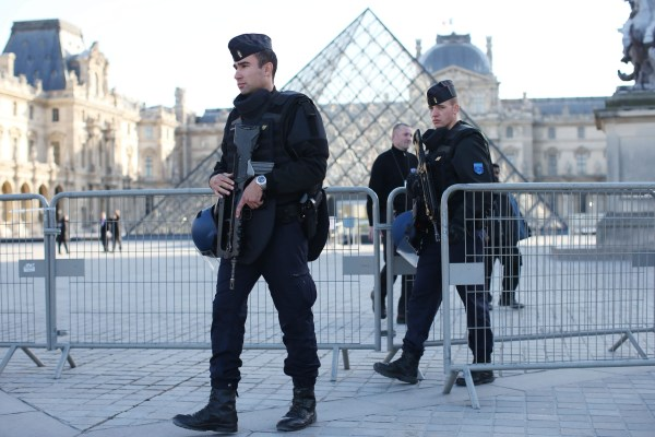 Image: Police walk around the closed Louvre museum