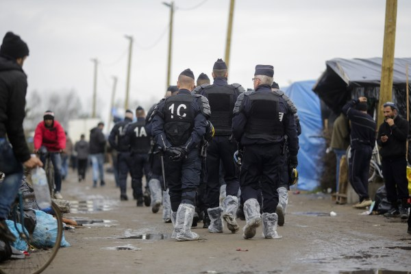 "Image: Police patrol ""The Jungle"" camp in Calais, France, on Nov. 4"