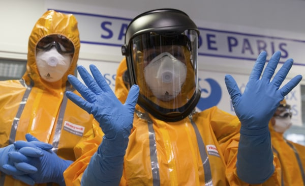 Image: Staff wearing Ebola protection outfits at Necker Hospital in Paris on Oct. 24, 2014
