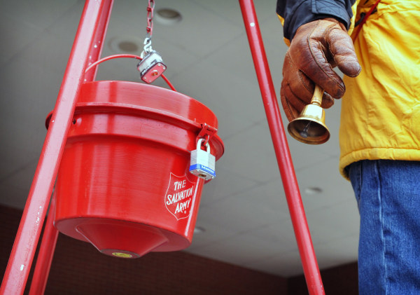 Image: A man rings a bell at a Salvation Army donation kettle