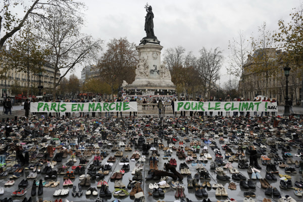 Image: Hundreds of pairs of shoes are displayed at the Place de la Republique, in Paris.