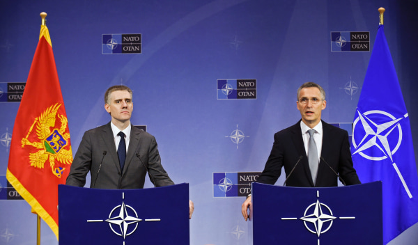 Image: NATO Secretary General Jens Stoltenberg and Montenegro's Foreign Minister Igor Luksic