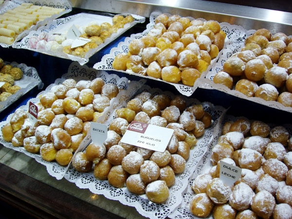 Cake Shop in Madrid. All saints day festivity typical cakes (bunuelos and huesos de santo) in a shop window.