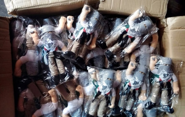 Image: Some of the 4,000 dolls in a box
