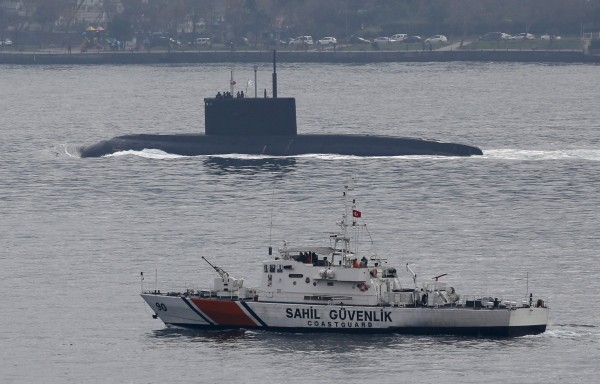 Image: Russia's diesel-electric submarine Rostov-on-Don is escorted by a Turkish Navy Coast Guard boat as it sets sail in the Bosphorus, on its way to the Black Sea, in Istanbul, Turkey