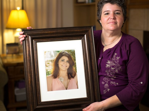 Image: Image: Jennifer Foley holds a photo of her daughter, Rebecca Foley