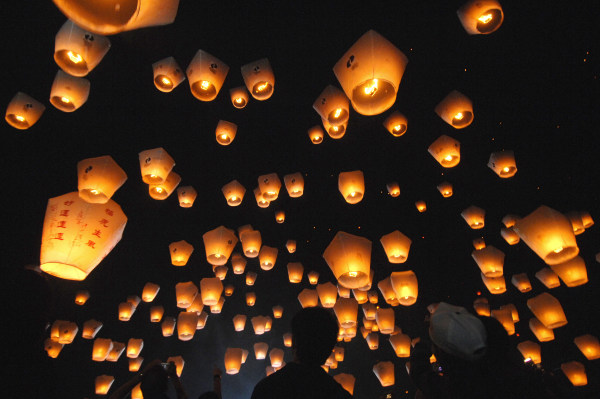 Image: People release sky lanterns in Pinghsi,