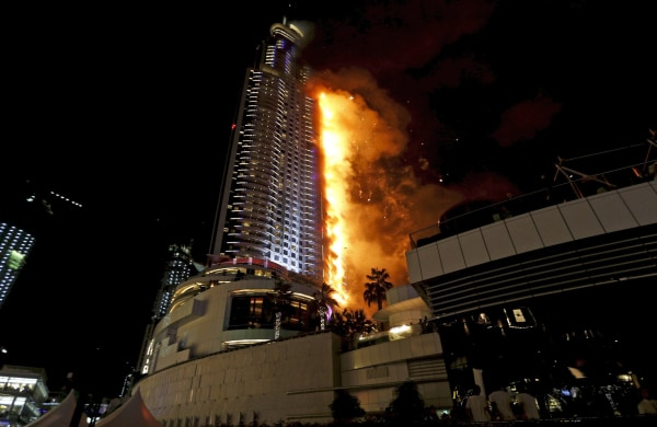 Image: A fire engulfs The Address Hotel in downtown Dubai in the United Arab Emirates