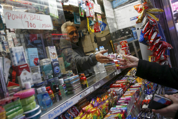 Image: A vendor sells a ticket for the $700 million Powerball lottery draw at Times Square in the Manhattan borough of New York