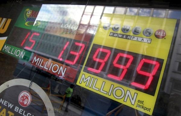 Image: A light sign could not fit the record highest power ball payout at a local liquor store in Washington