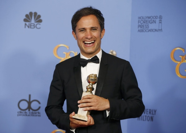 "Image: Actor Gael Garcia Bernal poses backstage with the award for Best Performance by an Actor in a Television Series - Musical or Comedy for his role in ""Mozart in the Jungle"" at the 73rd Golden Globe Awards in Beverly Hills"