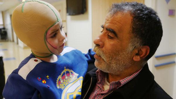 Image: Hossein Dawabsheh holds his 4-year-grandson Ahmad Dawabsheh.