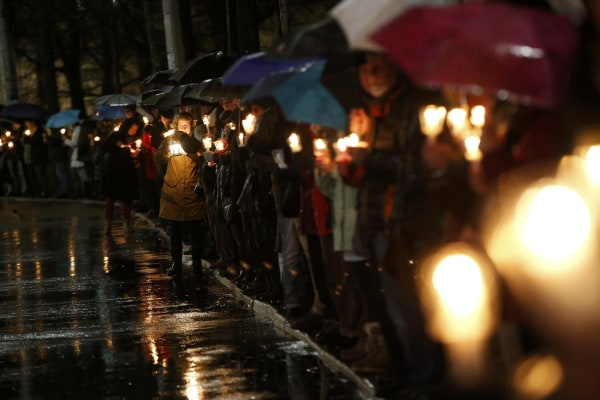Image: Participants hold candles during a counter-protest against the anti-Islam movement Patriotic Europeans Against the Islamization of the West (PEGIDA), in Leipzig, Monday.