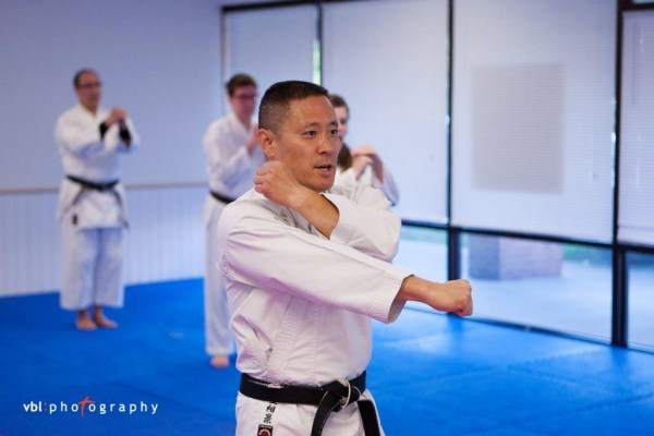 Image: Officer Sonny Kim teaching karate at his school in Ohio