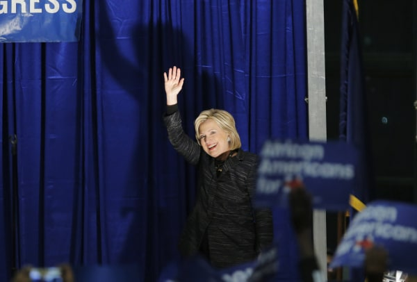 Image: Clinton waves as she is announced on the stage during Jim Clyburn's Annual Fish Fry in Charleston