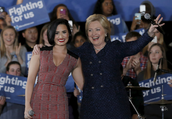Image: U.S. Democratic presidential candidate Hillary Clinton is joined by singer Demi Lovato at a campaign event in Iowa City