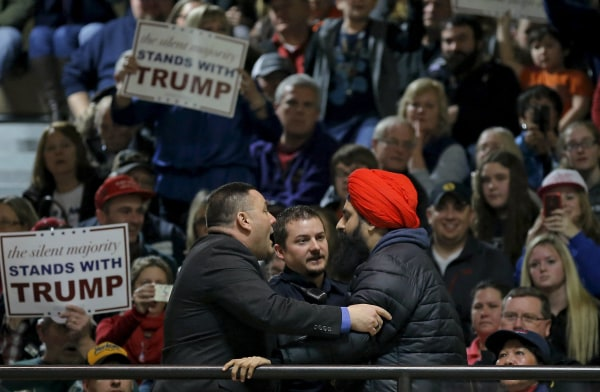 Image: A protester is escorted out of a U.S. Republican presidential candidate Donald Trump campaign event in Muscatine