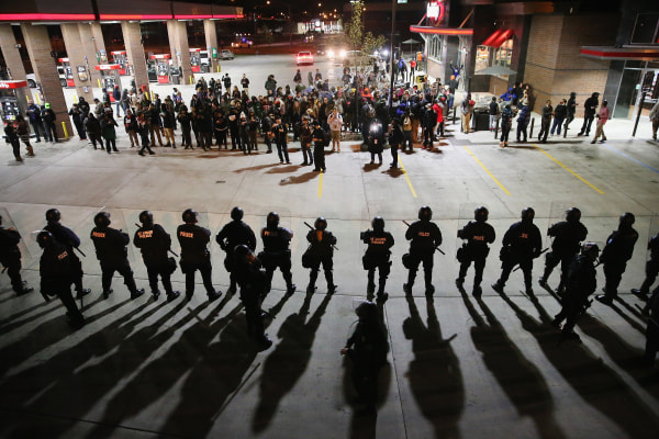 Image: Demonstrators protesting the killings of 18-year-olds Michael Brown by a Ferguson