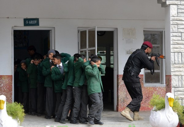 IMAGE: A Pakistani Elite Police Force member takes part in a drill to fight against militants at a schoolhool