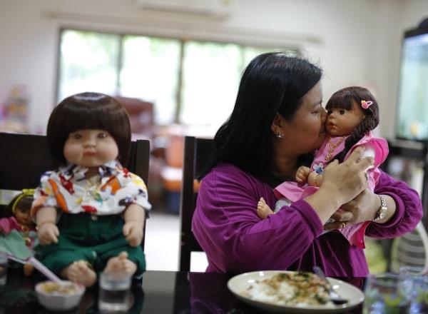 "Image: Ratchada Mahanavanont with ""child angel"" doll"