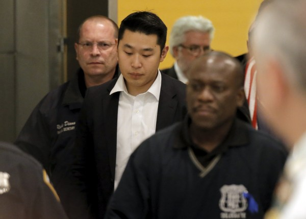 Image: New York City Police officer (NYPD) Peter Liang is led from the court room at the Brooklyn Supreme court in the Brooklyn borough of New York
