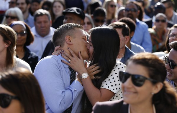 Image: Married medical students kiss after matching with hospitals in March 2015 in Irvine, Calif.