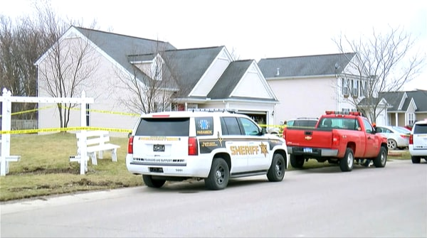 Image: Emergency vehicles and investigators outside the home